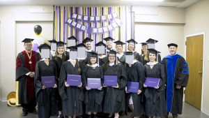 Dallas International graduates with Dr. Doug Tiffin, President (L), and Dean of Academic Affairs, Dr. Scott Berthiaume (R). Eighteen of the twenty-three graduates were in attendance. For reasons of privacy, some graduates have requested that their faces be obscured.